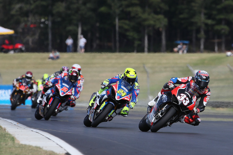 Kyle Wyman (33) leads Toni Elias (24), Josh Herrin (2) and others during a Superbike race at Barber Motorsports Park.