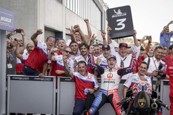Jack Miller and his team celebrate his third-place finish in parc ferme.