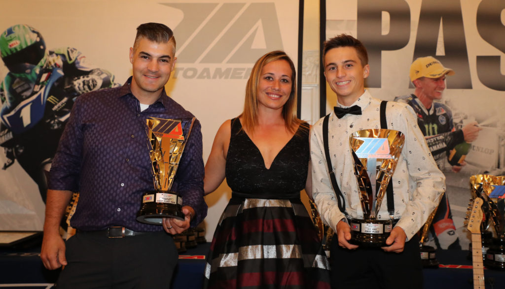(From left to right) Team Manager Chris Ulrich, MotoAmerica Operations Manager Niccole Cox and Twins Cup Champion Alex Dumas. Photo by Brian J. Nelson.