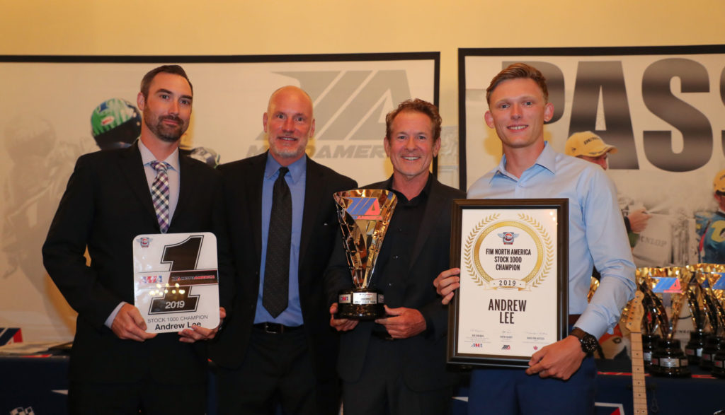 (From left to right) Crew chief Derek Keyes, Massey, MotoAmerica Communications Manager Paul Carruthers and Andrew Lee hold Lee's MotoAmerica Stock 1000 Championship awards. Photo by Brian J. Nelson.