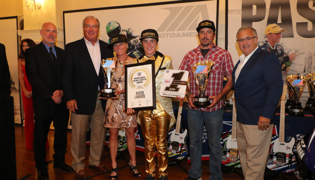 (From left to right) Massey, MotoAmerica Partner Richard Varner, Jamie Landers [Rocco's mother], Rocco Landers, Stoney Landers [Rocco's father], and Liqui Moly's Vinny Russo celebrate Rocco's Liqui Moly Junior Cup title. Photo by Brian J. Nelson.