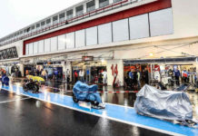 World Endurance racebikes under covers on pit lane at the Bol d'Or 24-Hours race in France.
