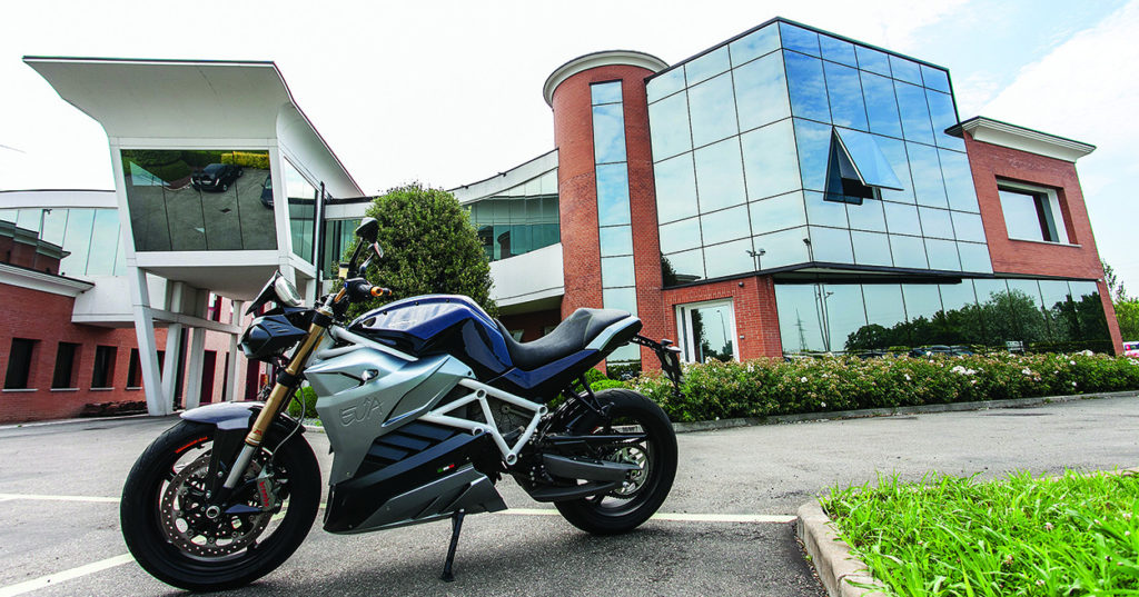 Energica Motor Companys headquarters in Modena, Italy, with an Eva electric streetbike model parked outside. Photo by Damiano Florentini.