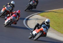 Dave Roper (7) leads Alex McLean (122), Walt Fulton (177X), and Jack Parker (18) early in the AHRMA Vintage Cup (350 GP) race on October 5 at Barber Motorsports Park. Photo by etechphoto.com, courtesy of AHRMA.