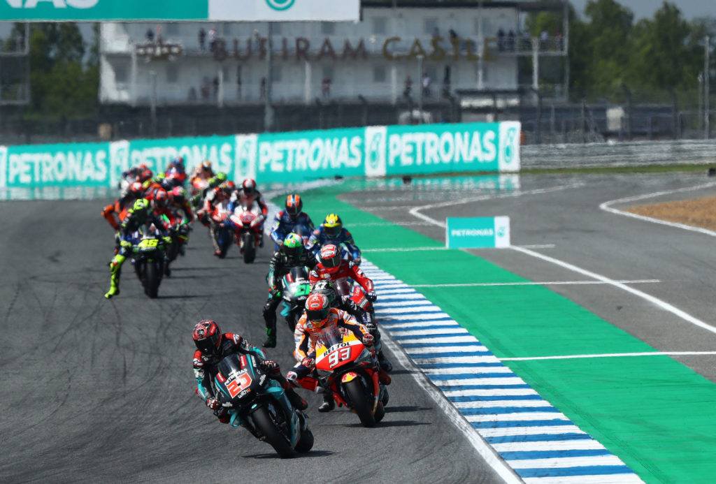 Fabio Quartararo (20) leads Marc Marquez (93) and the rest of the field early in the MotoGP race in Thailand. Photo courtesy of PETRONAS Yamaha SRT.