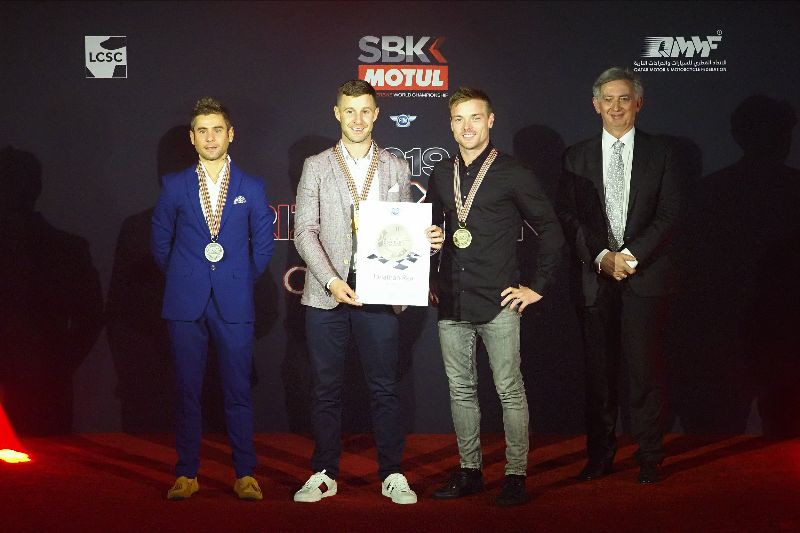 2019 FIM Superbike World Champion Jonathan Rea (second from left) with Championship runner-up Alvaro Bautista (far left), third-place Championship finisher Alex Lowes (second from right), and FIM Board Member Jos Driessen (far right). Photo courtesy of Dorna WorldSBK Press Office.