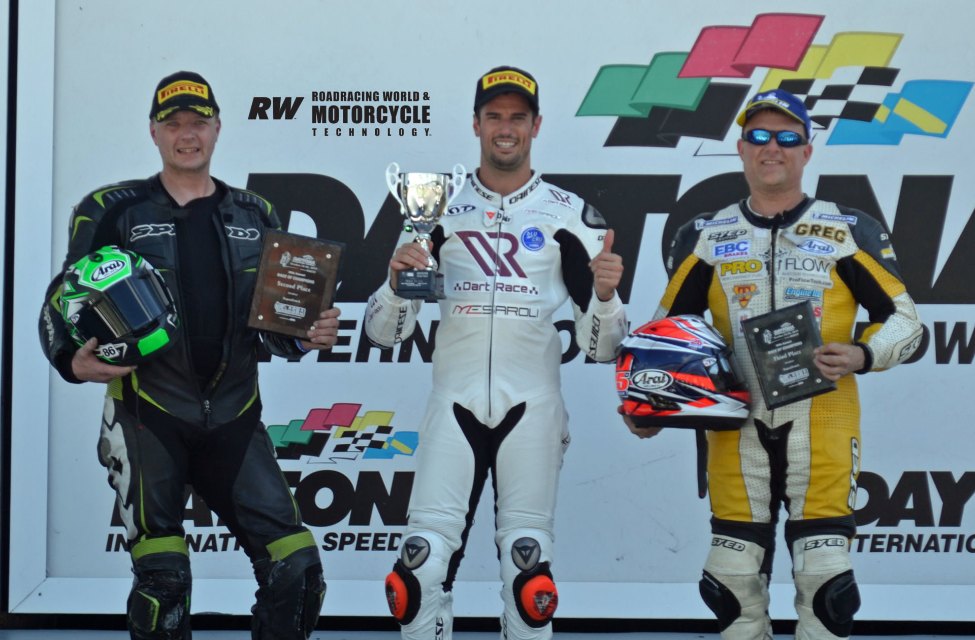 ASRA Sportbike race winner Simone Corsi (center), runner-up Jason Farrell (left), and third-place finisher Greg Melka (right) on the podium in Victory Lane at Daytona International Speedway. Photo by David Swarts.