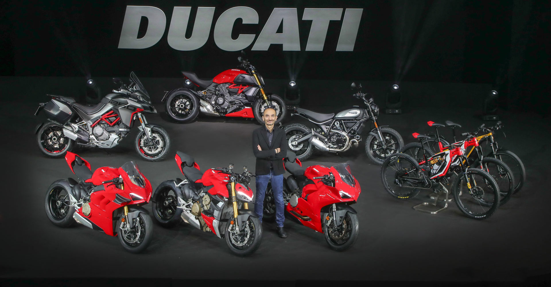 Ducati CEO Claudio Domenicali with Ducati's new 2020-model motorcycles and Ebikes. Photo courtesy of Ducati.