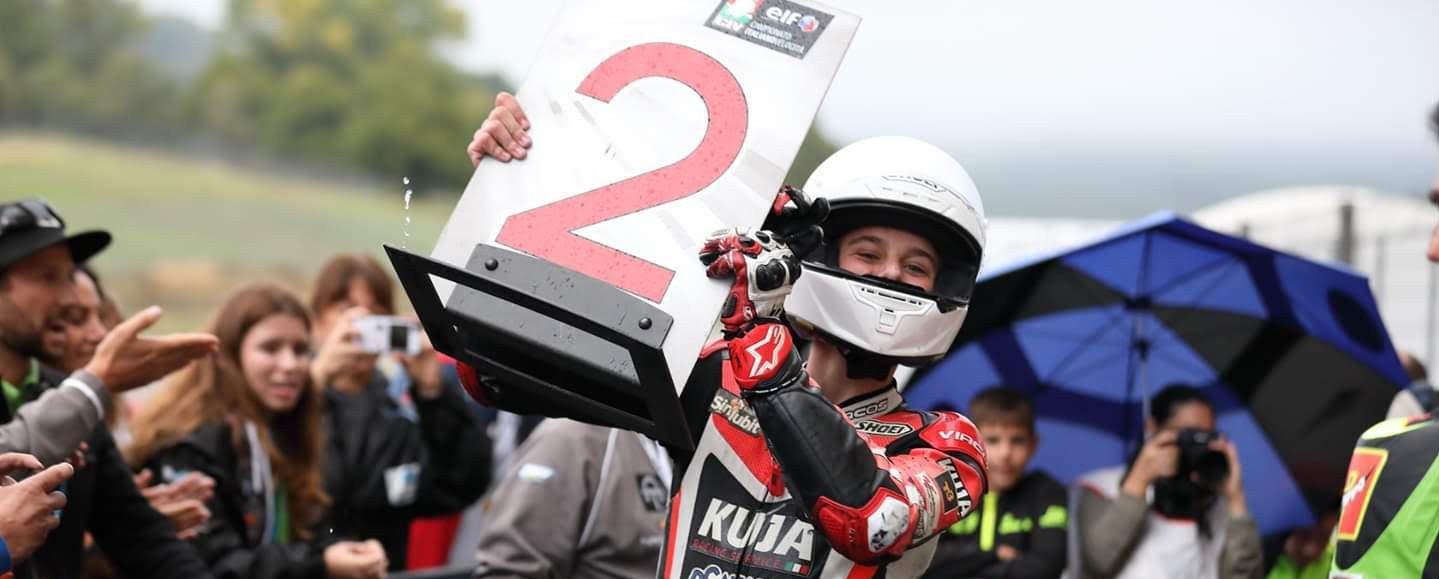 American Max Toth celebrates his second-place finish in a CIV PreMoto3 race in parc ferme at Mugello.