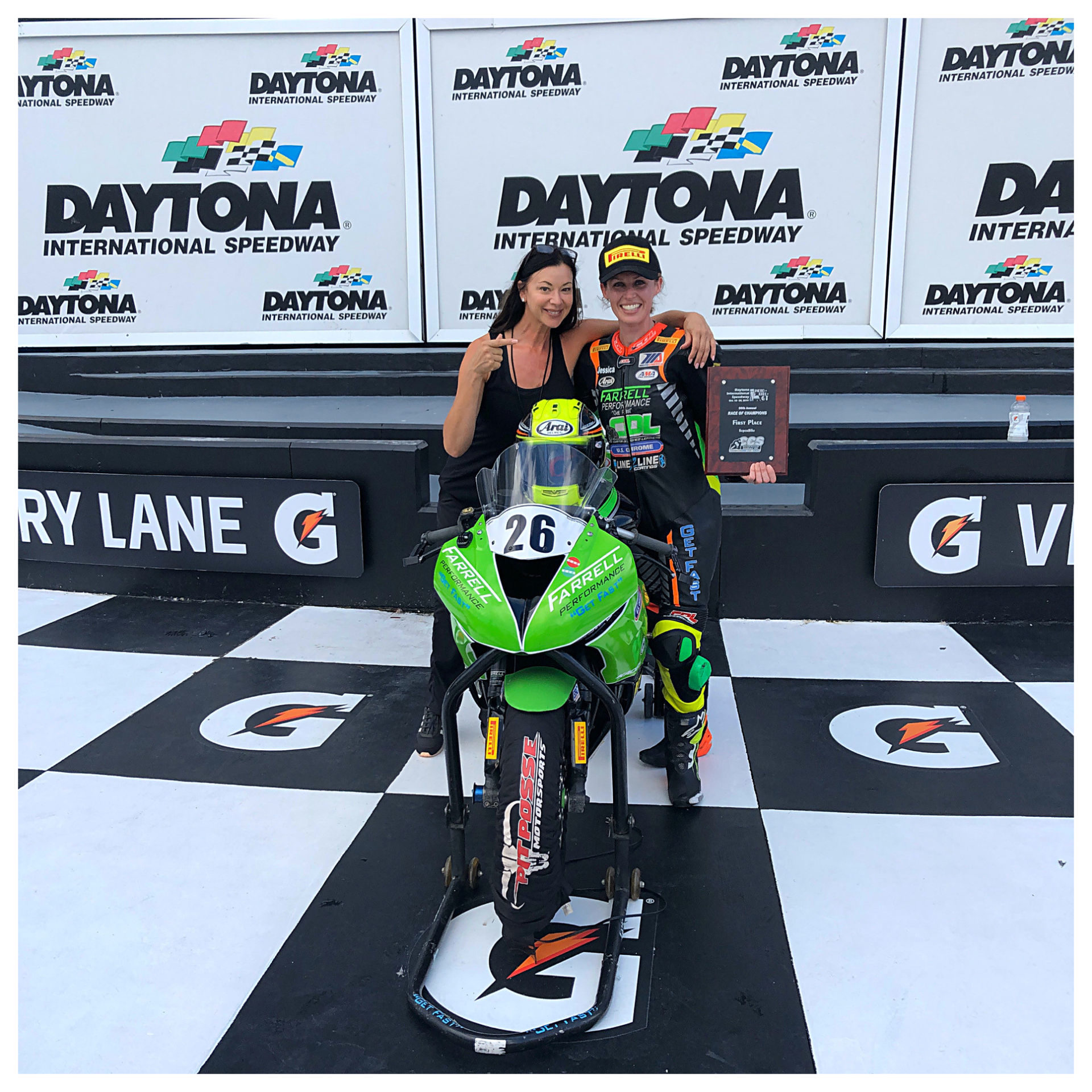 Angela Izzo-Sink, Operating Director of MotoGirlGT Roadracing Championship Series (left), and MotoGirlGT Superbike race winner Jessica Capizzi (right) in Victory Lane at Daytona International Speedway. Photo courtesy of Angela Izzo-Sink.