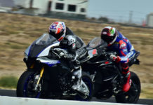 Former MotoGP World Champion Casey Stoner (left) and former AMA Superbike Champion Josh Herrin (right) on the main straight at Willow Springs International Raceway. Photo by Michael Gougis.