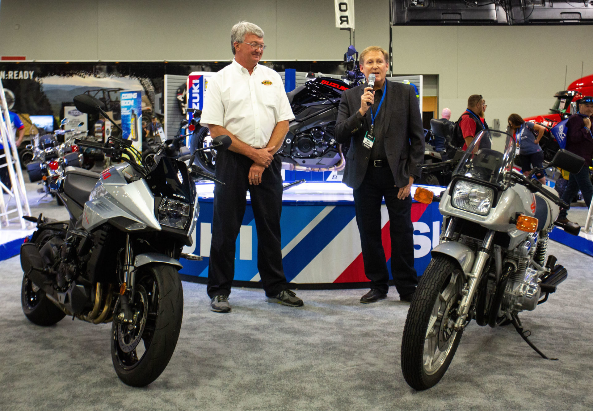 Barber Museum's Jeff Ray (left) and Suzuki's Kerry Graeber (right) with the original 1982 GSX1100S Katana and the 2020 KATANA in Metallic Mystic Silver and Solid Black. Photo courtesy of Suzuki Motor of America., Inc.