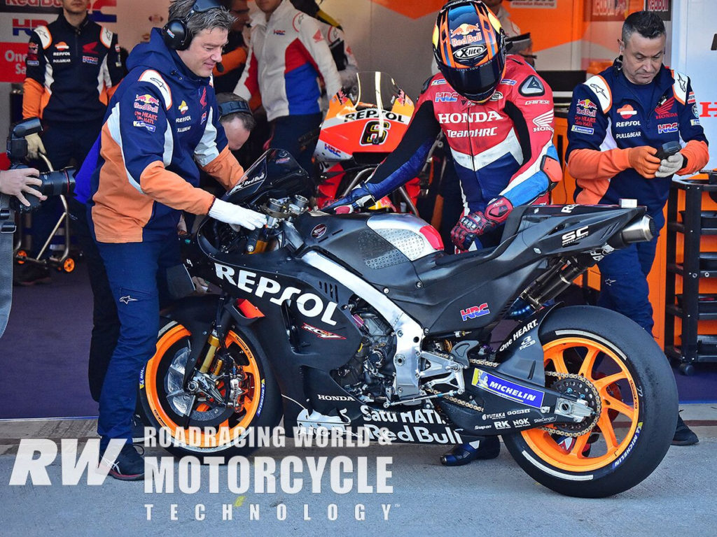 (Above) Early in the morning, Stefan Bradl tested with reflective material over the front brakes, designed to help keep heat in the discs. Photo by Michael Gougis.