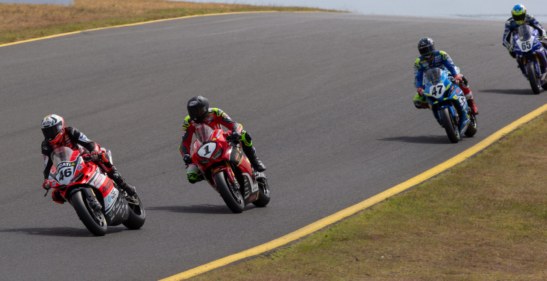 Mike Jones (46) leads Troy Herfoss (1), Wayne Maxwell (47), and Cru Halliday (65) at Sydney Motorsport Park. Photo by Andrew Gosling/TBG Sport, courtesy of Motorcycling Australia.