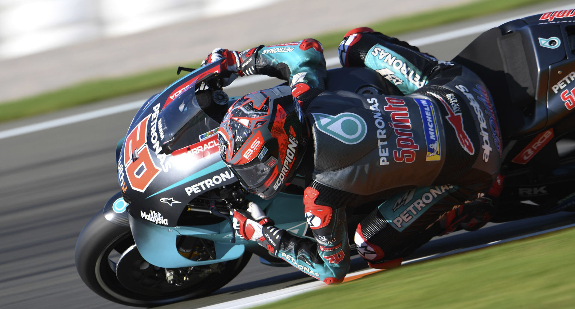 Fabio Quartararo (20) at speed at Valencia. Photo courtesy of PETRONAS Yamaha SRT.