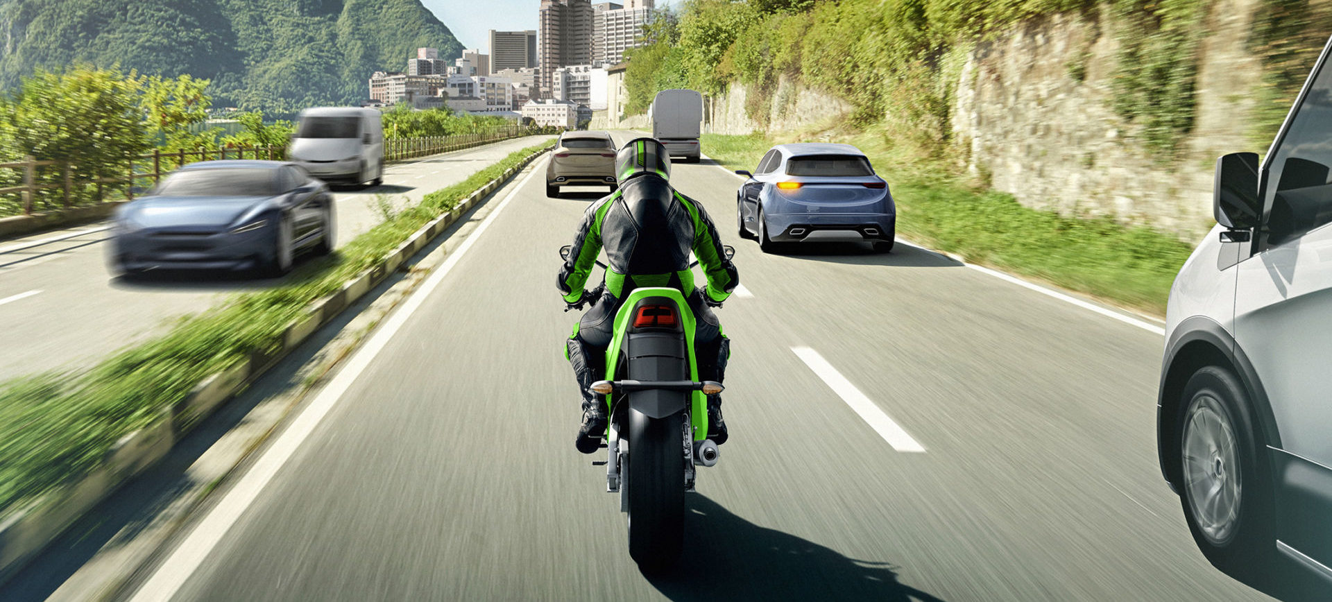 A computer-generated image of a Kawasaki motorcycle being ridden in challenging traffic conditions. Image courtesy of Kawasaki UK.