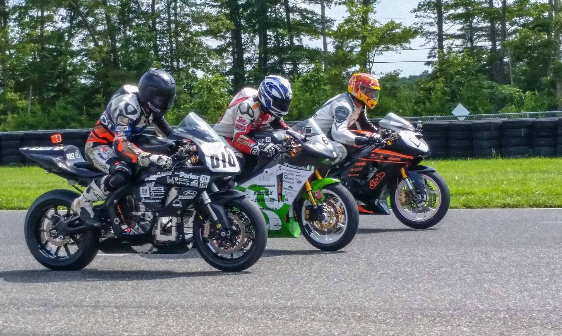 Electric motorcycles as built by students at (from left) Virginia Tech, the University of Sherbrooke in Quebec, and the Rochester Institute of Technology at AHRMA's 2019 Varsity Challenge. Photo courtesy of AHRMA.