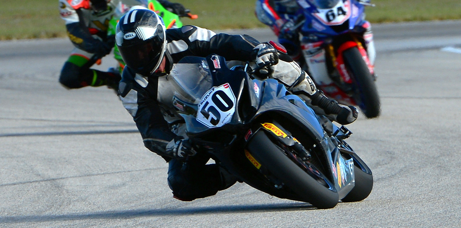 Sean Dwyer (50) leading Eric Wood and Max Angles (64) during the CCS Unlimited Grand Prix race at Homestead-Miami Speedway. Photo by Lisa Theobald, courtesy of ASRA/CCS.