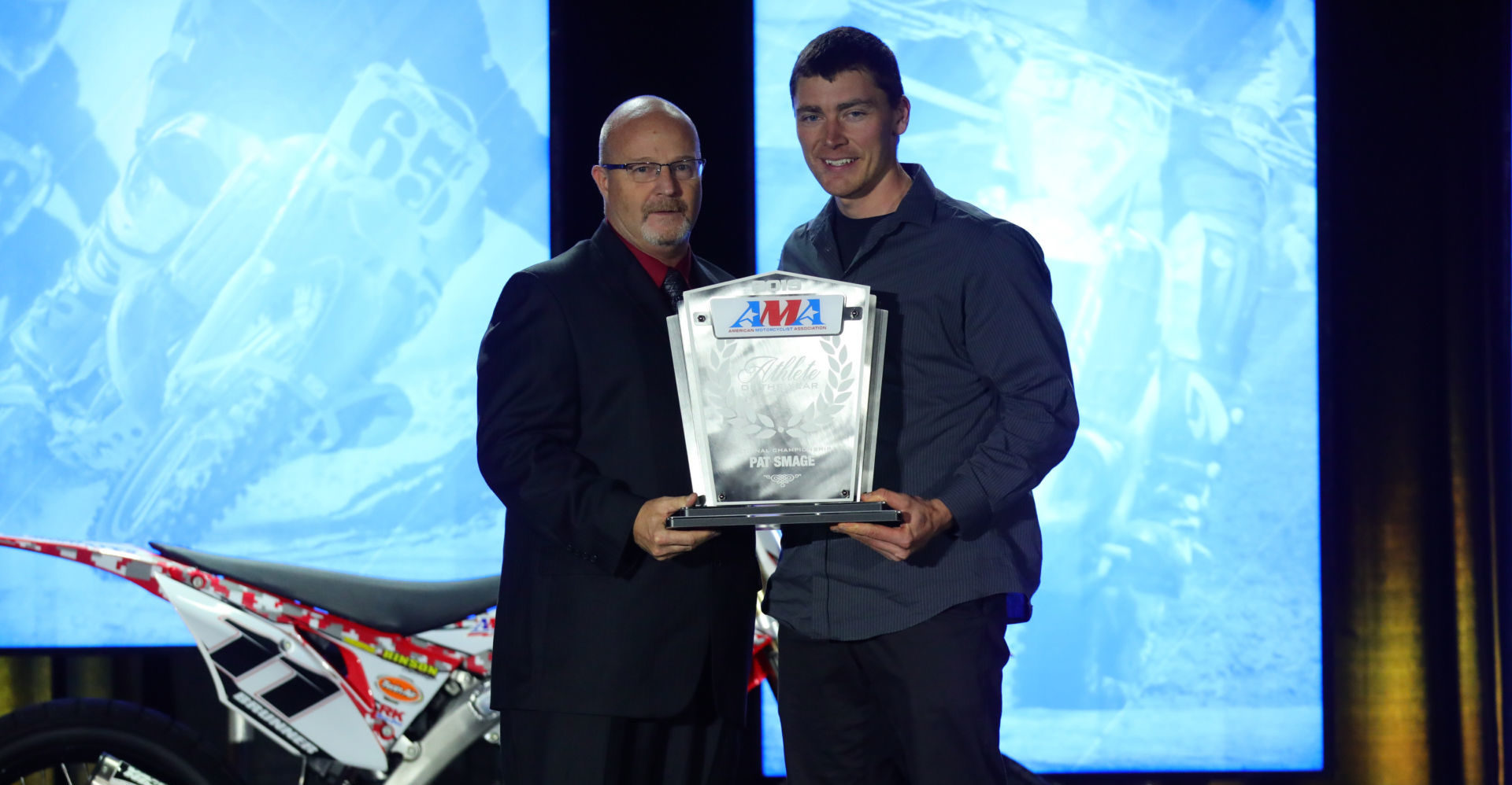AMA Director of Racing Kevin Crowther (left) presents the 2019 AMA Athlete of the Year from AMA National Championship Series Award to 11-time AMA/NATC MotoTrials Pro Class National Champion Pat Smage at the 2019 KTM AMA Championship Banquet. Photo by Jeff Kardas, courtesy of AMA.