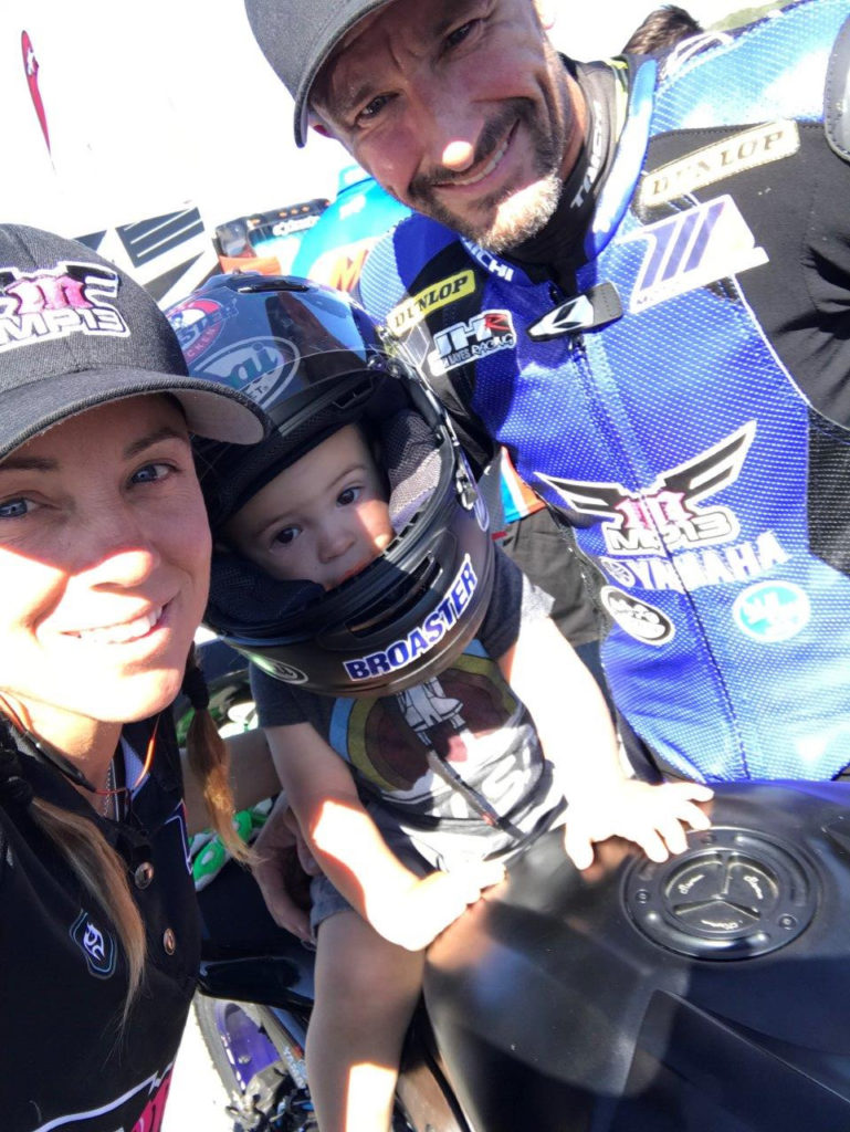 Josh Hayes (right), wife Melissa Paris (left), and two-year-old son Hawk (center). Photo courtesy of Phillip Island Grand Prix Circuit.