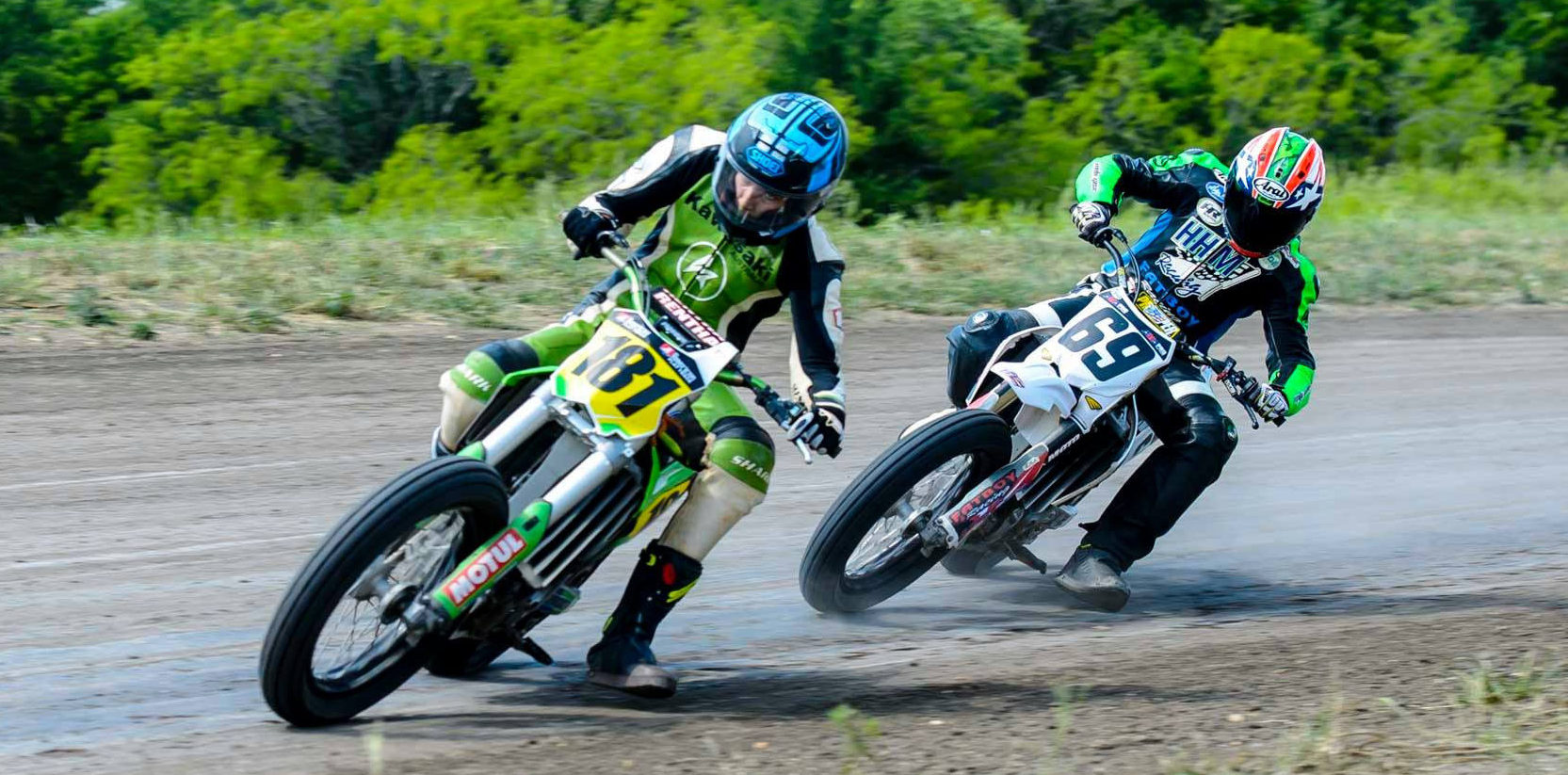 Max Whale (181) and Dallas Daniels (69) during a Vintage Dirt Track Racing Association (VDTRA) event. VDTRA is the predecessor of Xtreem Flat Track. Photo by Ken Kerr, courtesy of Xtreem Flat Track.