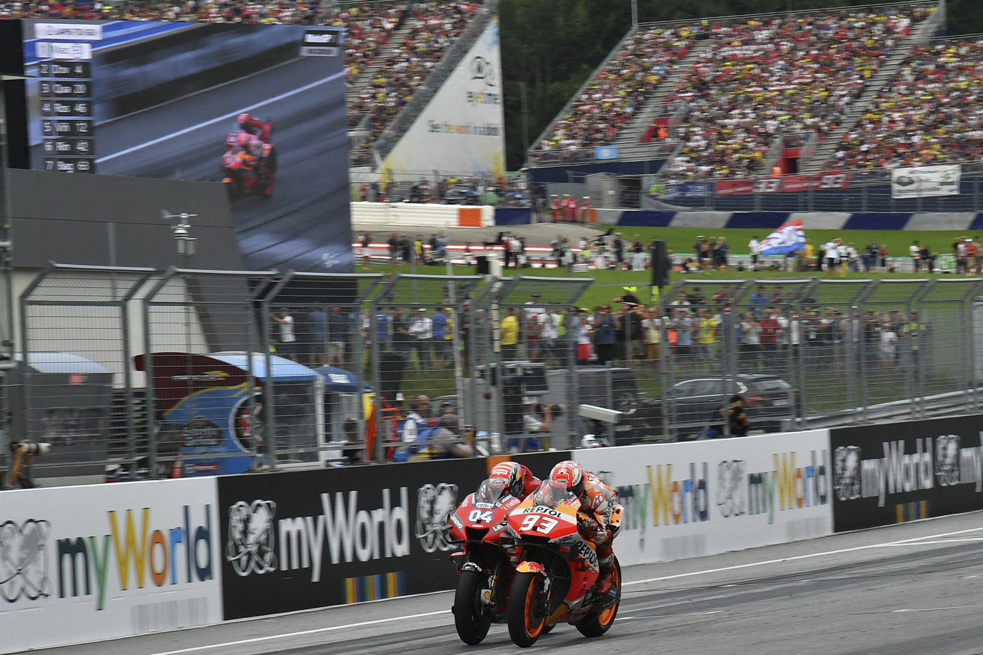 Marc Marquez (93) and Andrea Dovizioso (04) battled to the finish of the 2019 Austrian Grand Prix at the Red Bull Ring, in Austria. Photo courtesy of Dorna/www.motogp.