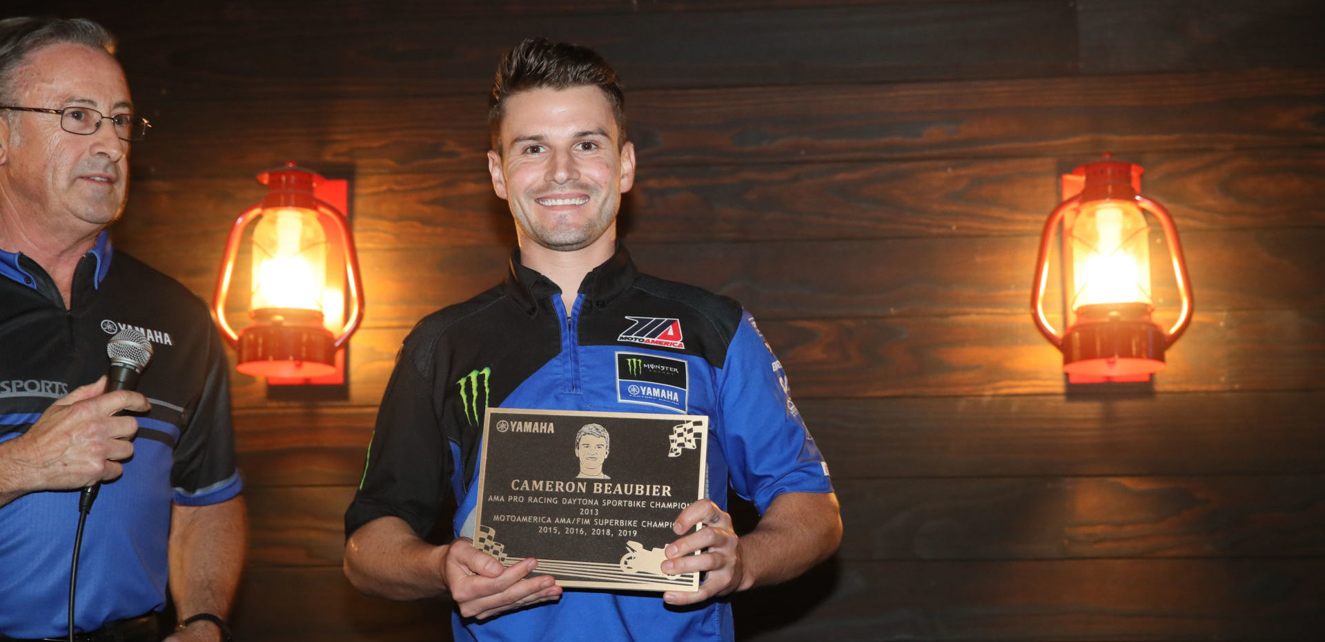 Four-time MotoAmerica Superbike Champion Cameron Beaubier (right), seen here with his 2019 team manager Tom Halverson (left), was one of the eight Yamaha racers honored in a ceremony in front of Yamaha employees in the Atlanta, Georgia area. Photo courtesy of Yamaha Motor Corp., U.S.A.