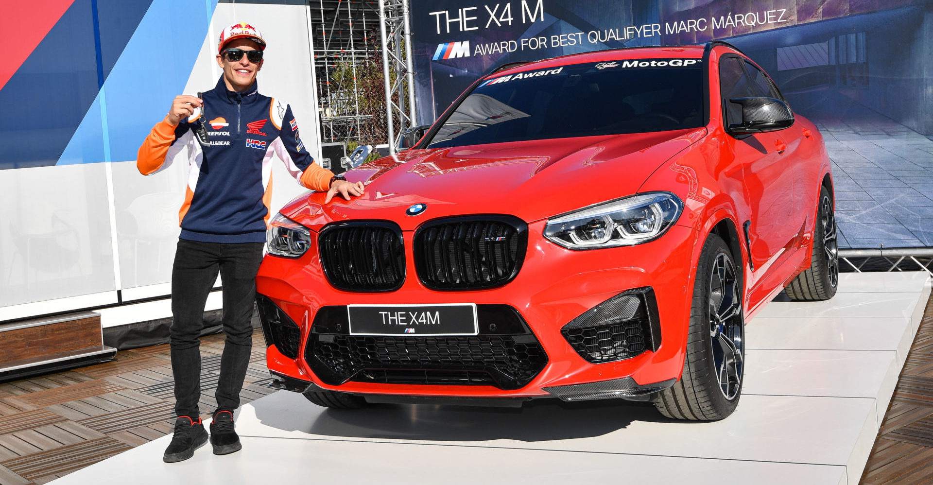 Marc Marquez with the BMW M Award grand prize - a BMW X4 M Competition. Photo courtesy of Dorna.