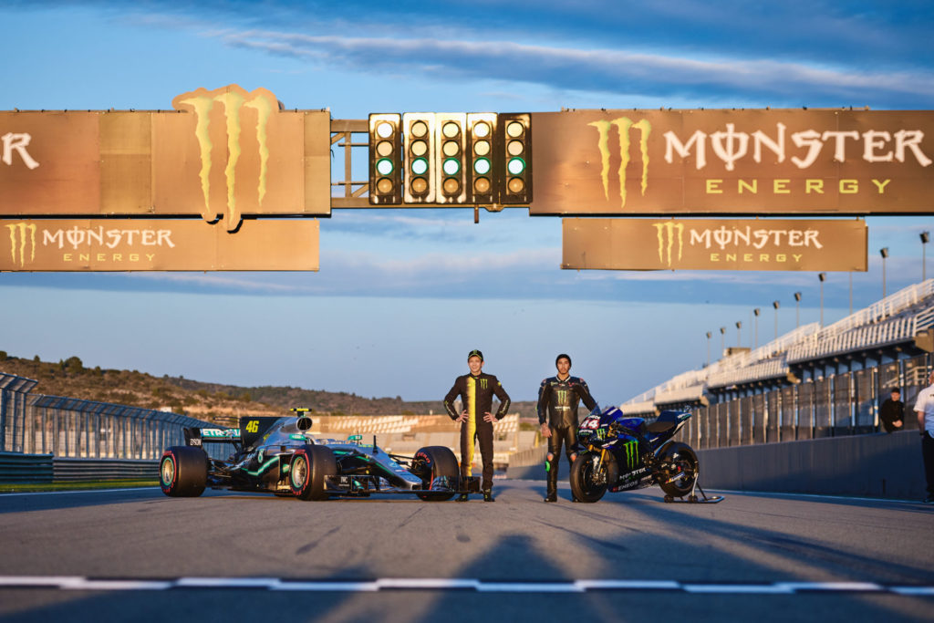 Formula One race car driver Lewis Hamilton with a Monster Energy Yamaha YZR-M1 MotoGP racebike (right) and MotoGP racer Valentino Rossi (46) with a Mercedes-AMG F1 W08 EQ Power+ Formula One race car (left) at Valencia. Photo courtesy of Monster Energy Yamaha.