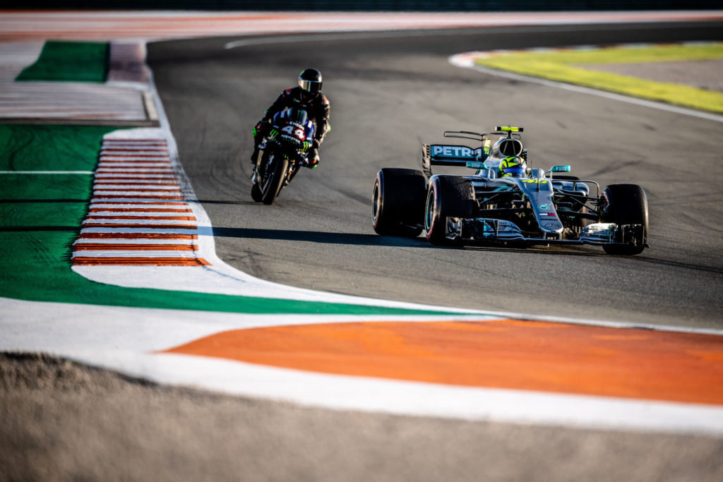 Formula One race car driver Lewis Hamilton on a Monster Energy Yamaha YZR-M1 MotoGP racebike (44) and MotoGP racer Valentino Rossi (46) in a Mercedes-AMG F1 W08 EQ Power+ Formula One race car (46) at Valencia. Photo courtesy of Monster Energy Yamaha.
