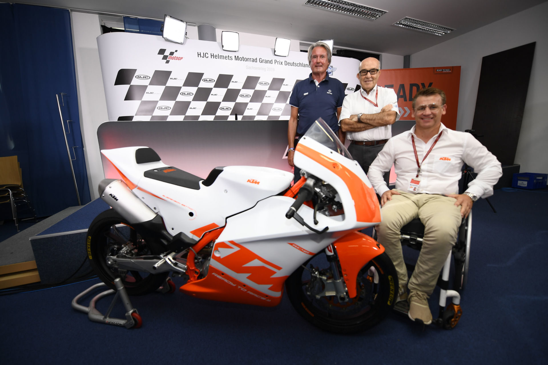 Herman Tomczyk, ADAC Sports President (left); Carmelo Ezpeleta, CEO of Dorna Sports (center); and Pit Beirer, KTM Motorsports Director (right), with a KTM RC4R racebike at the announcement of the Northern Talent Cup. Photo courtesy of Dorna.