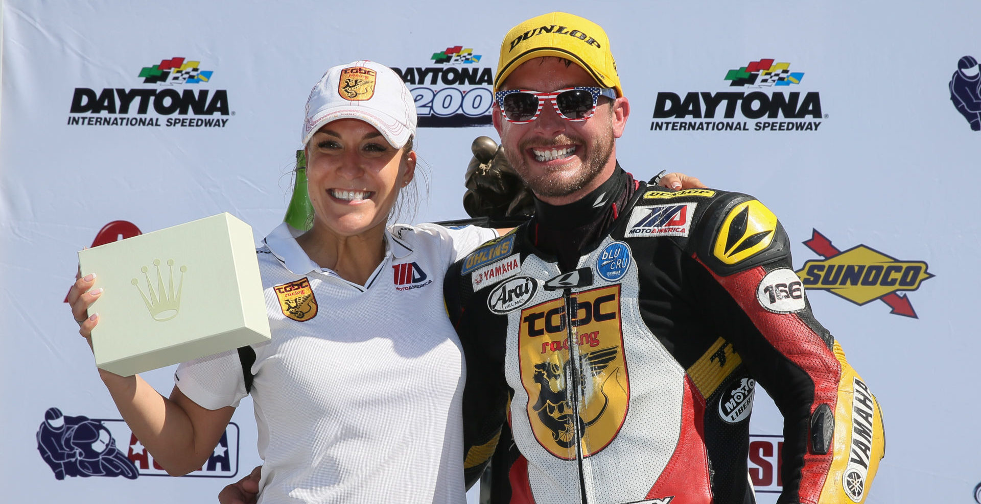 TOBC Racing Team Owner Michelle Lindsay (left) with rider Danny Eslick (right) after winning the 2018 Daytona 200, their third win together and Eslick's fourth Daytona 200 win overall. Lindsay, Eslick, and TOBC Racing will be honored during a celebration on March 11 at the Daytona 200 Memorial in Daytona Beach, Florida. Photo by Brian J. Nelson.