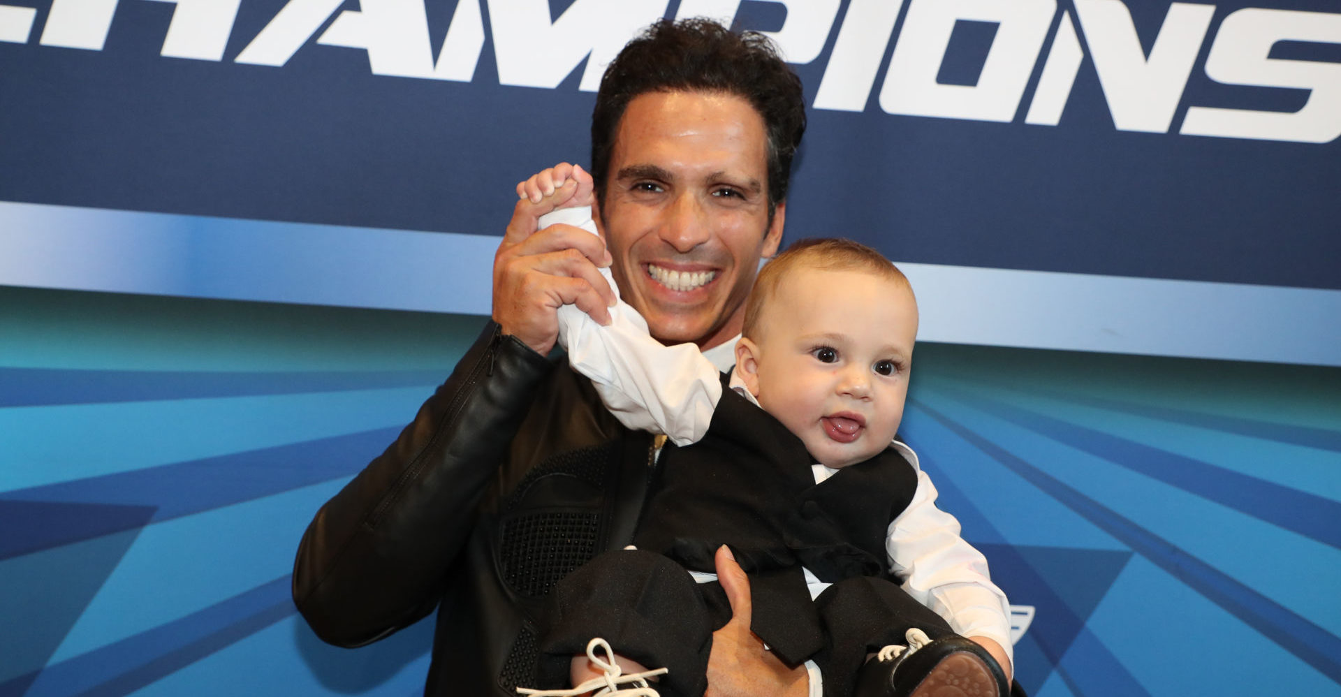 Toni Elias (shown with son Antoni) will join Team Hammer for the 2020 MotoAmerica Superbike Championship on an M4 ECSTAR Suzuki GSX-R1000. Photo by Brian J. Nelson, courtesy of Suzuki Motor of America, Inc.