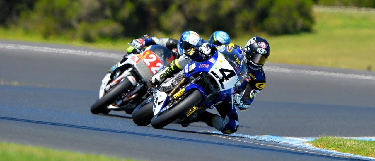 Josh Hayes (4) leads Jed Metcher (22) at Phillip Island. Photo by Russell Colvin, courtesy of Phillip Island Grand Prix Circuit.