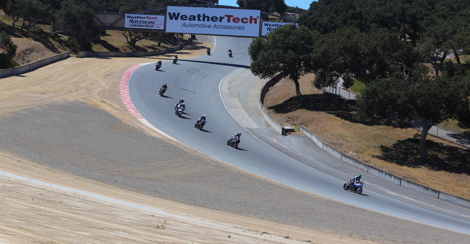 Motorcycles on track at WeatherTech Raceway Laguna Seca. Photo by Etechphoto.com, courtesy of AHRMA.