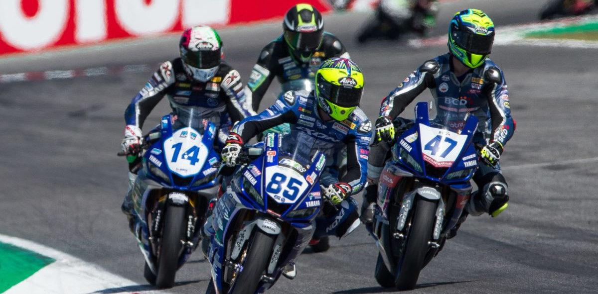 Riders at speed on Yamaha YZF-R3 racebikes. Photo courtesy of Yamaha.
