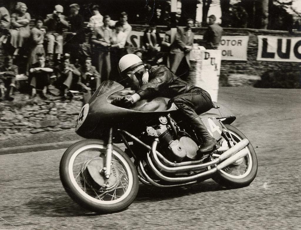 John Surtees riding a 1956 MV Agusta 350cc four-cylinder Grand Prix racebike. Photo courtesy of MV Agusta.