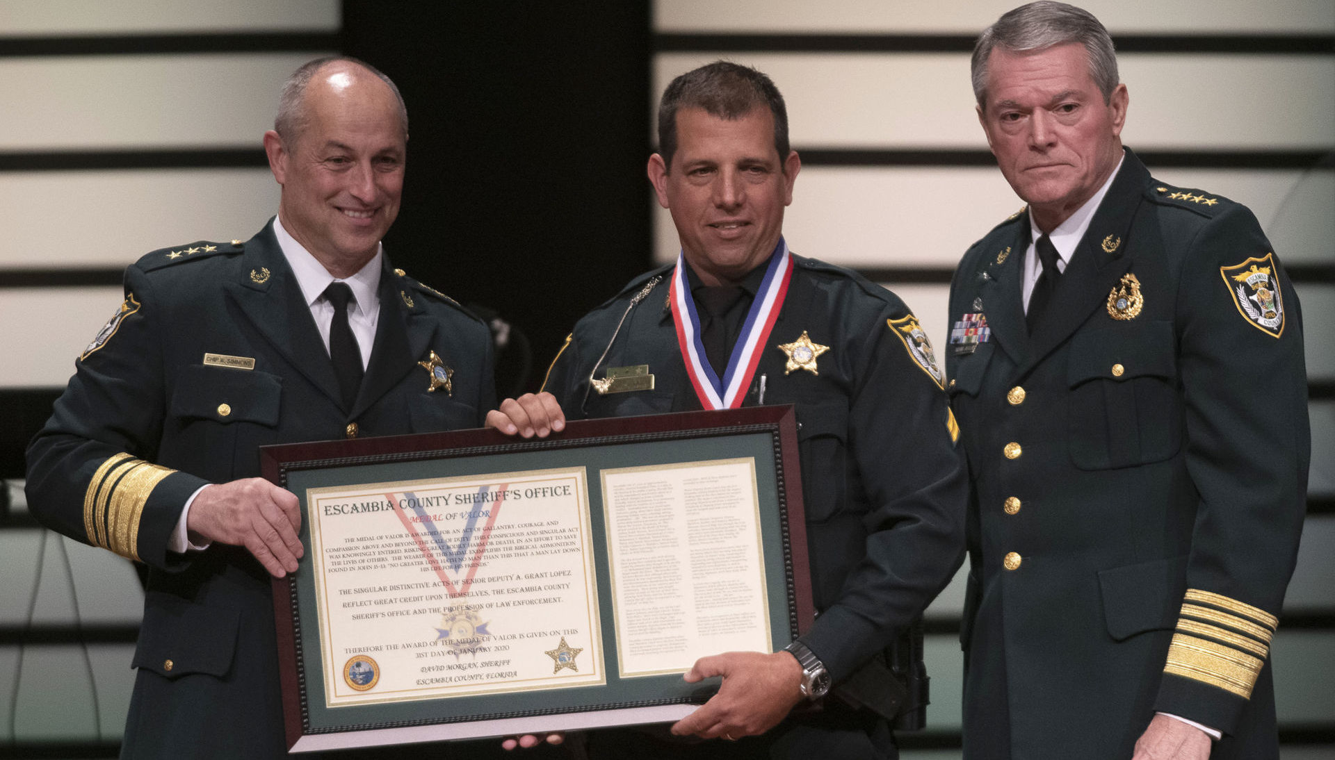 Escambia County Sheriff David Morgan (left), Senior Deputy A. Grant Lopez (center), and Chief Deputy Chip Simmons (right) at the Escambia County Sheriff's Office award ceremony January 31, 2019, in Pensacola, Florida. Photo courtesy of the Escambia County Sheriff's Office.