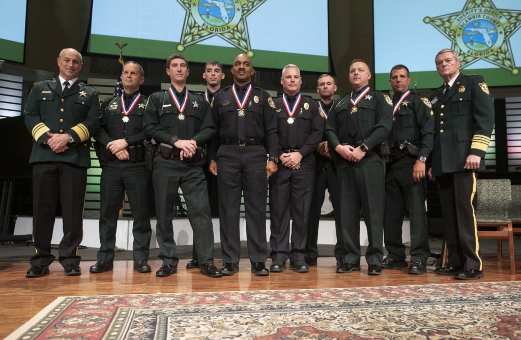 Grant Lopez (second from right) with the other law enforcement officers who were decorated for their actions on December 6, 2019. Photo courtesy of Escambia County Sheriff's Office.