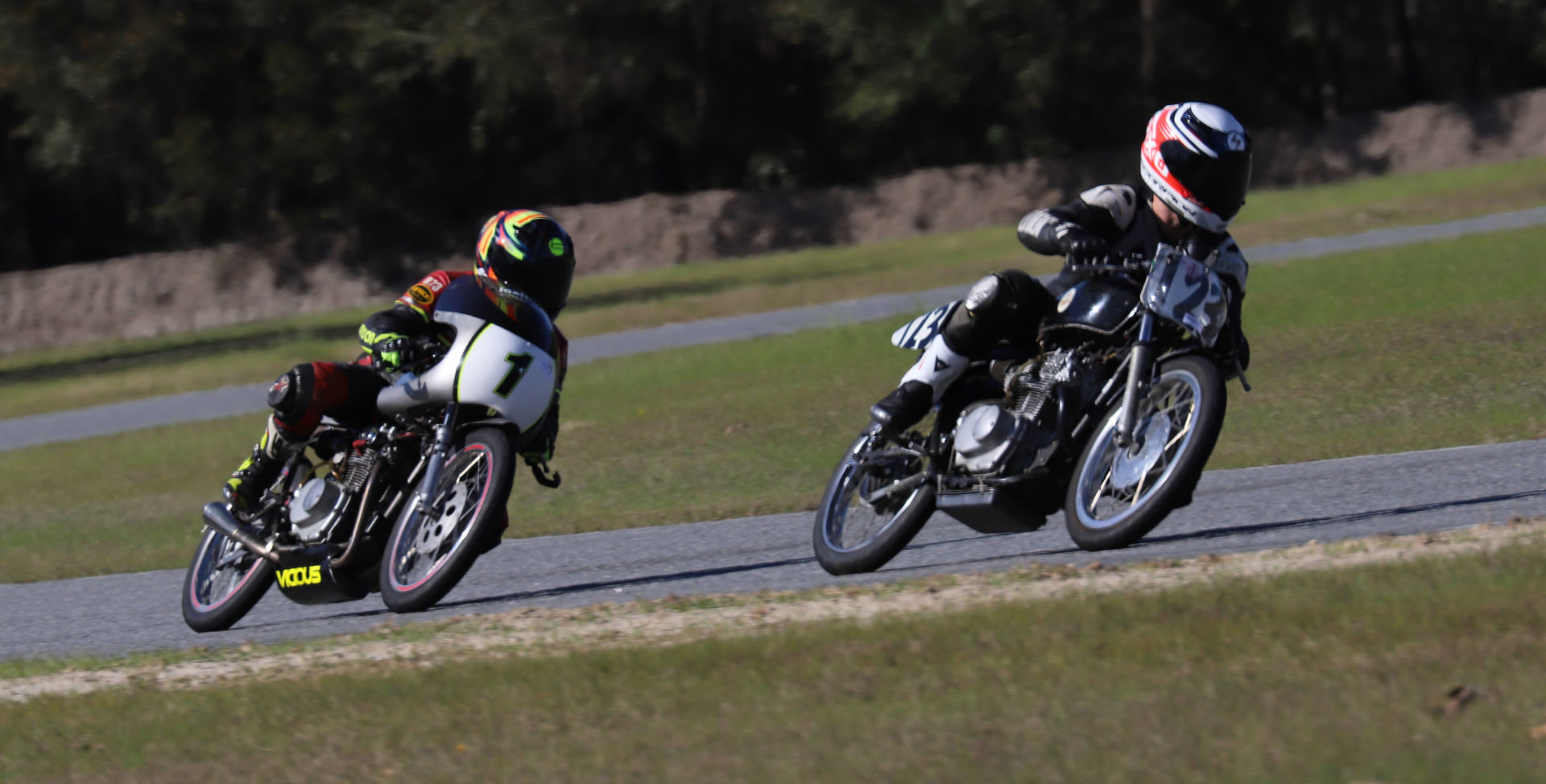 Jonas Stein (123) leads Greg Glevicky (1) during an AHRMA race at Roebling Road Raceway. Photo by etechphoto.com, courtesy of AHRMA.