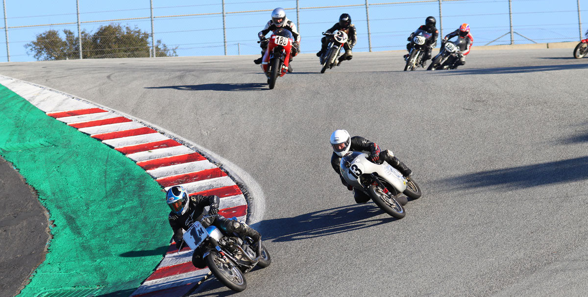 AHRMA racers Greg Tomlinson (1M), Jason Lindquist (13), Jarl Wathne (188), Mica Grohn (2V), Dustin Johnson (760), and Alex McLean (122) coming down the Corkscrew at WeatherTech Raceway Laguna Seca. Photo by etechphoto.com, courtesy of AHRMA.
