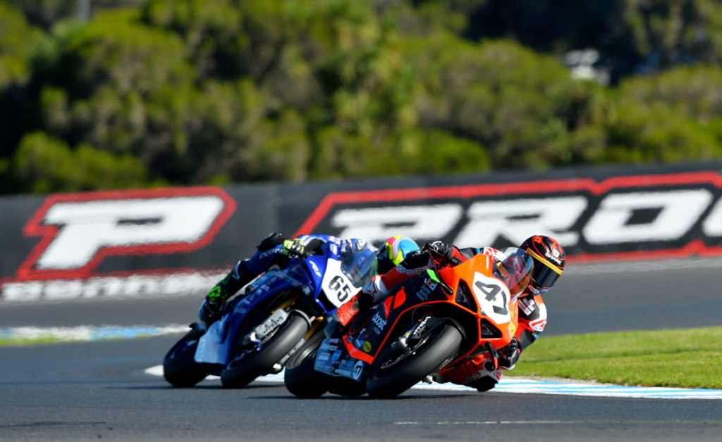 Wayne Maxwell (47) leads Cru Halliday (65) during Race Two at Phillip Island. Photo by Russell Colvin, courtesy Motorcycling Australia.