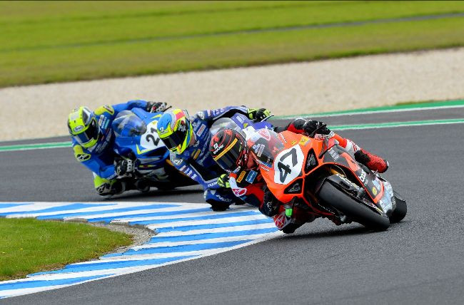 Wayne Maxwell (47) leads Cru Halliday and Josh Waters (25) during Race One at Phillip Island. Photo by Russell Colvin, courtesy of Motorcycling Australia.