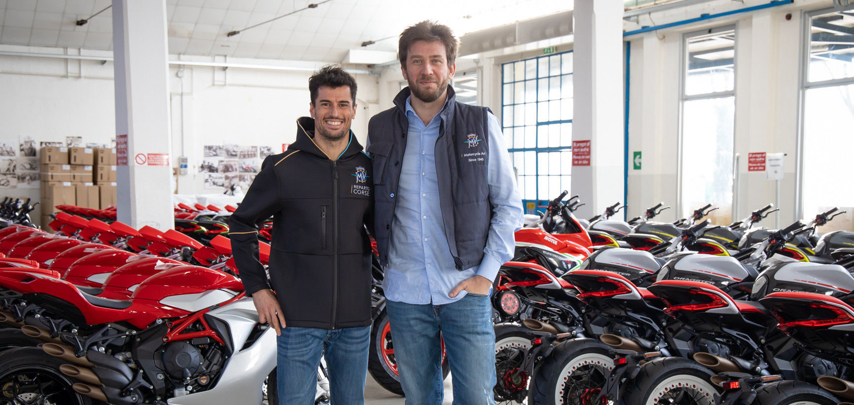Simone Corsi (left) and MV Agusta Chairman and CEO Timur Sardarov (right) at MV Agusta's factory in Italy. Photo courtesy of MV Agusta.