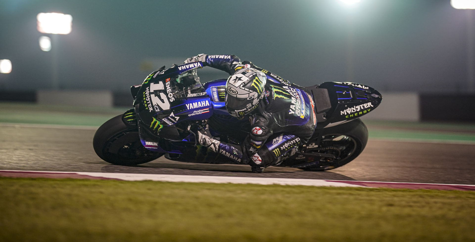 Maverick Vinales (12) at speed under the lights in Qatar. Photo courtesy of Monster Energy Yamaha.