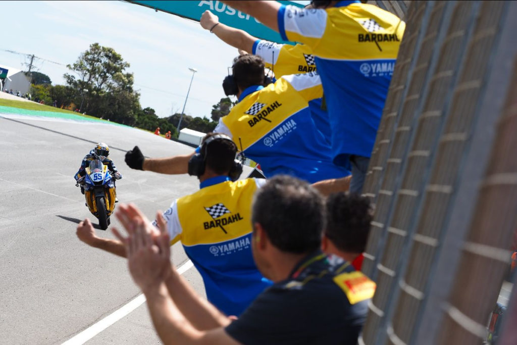 Andrea Locatelli (55) acknowledges his crew on his way to the checkered flag at Phillip Island. Photo courtesy of Dorna WorldSBK Press Office.