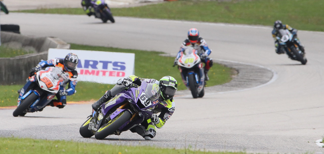 Hayden Gillim (69) leading Bobby Fong (50), Sean Dylan Kelly (40), and Josh Hayes (4) during a MotoAmerica Supersport race at Road America in 2019. Photo by Brian J. Nelson.