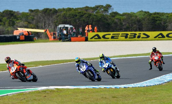 Wayne Maxwell (47) leads Cru Halliday (65), Josh Waters (21), and Troy Herfoss (17) during Race Three at Phillip Island. Photo by Russell Colvin, courtesy of Motorcycling Australia.