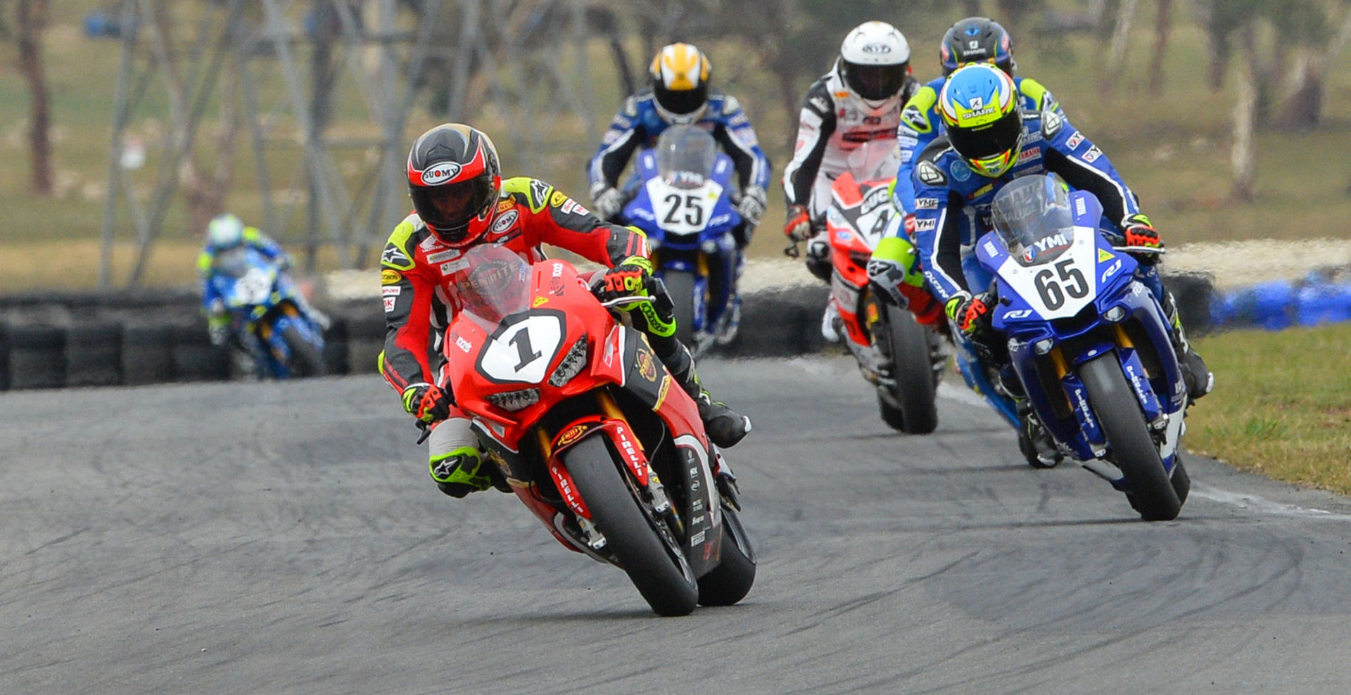 Former Australian Superbike Champion Troy Herfoss (1) leads Cru Halliday (65) and the rest of the Australian Superbike field at Wakefield Park in 2019. Photo by Russell Colvin, courtesy of Motorcycling Australia.
