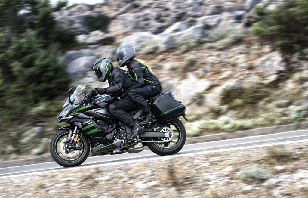 A 2020 Kawasaki Ninja 1000SX being ridden two-up with optional hard cases attached. Photo courtesy of Kawasaki.